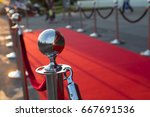 long red carpet between rope... | Shutterstock . vector #667691536