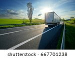 Truck Driving On Asphalt Road...