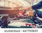 hands of car mechanic  working... | Shutterstock . vector #667703845