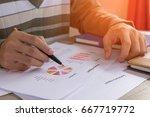 businessman check profit... | Shutterstock . vector #667719772