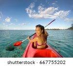 kayak woman having fun kayaking ... | Shutterstock . vector #667755202