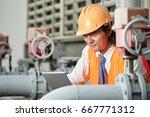 asian plant engineer reading... | Shutterstock . vector #667771312
