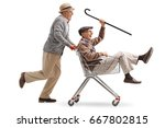 senior pushing another senior... | Shutterstock . vector #667802815