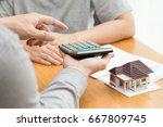 bank calculates the home loan... | Shutterstock . vector #667809745