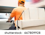 delivery man ride motorcycle... | Shutterstock . vector #667809928