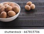 chicken egg in white bowl and 3 ... | Shutterstock . vector #667815706