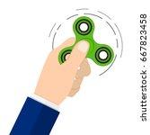 green hand fidget spinner toy... | Shutterstock .eps vector #667823458