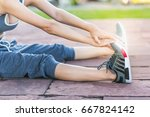 cute girl warm up on the park | Shutterstock . vector #667824142
