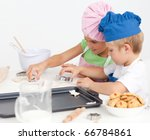 Two Adorable Children Making...