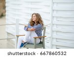 smiling young woman  in a... | Shutterstock . vector #667860532