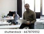 smiling happy afro american... | Shutterstock . vector #667870552