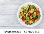 delicious fattoush or arab... | Shutterstock . vector #667899418