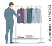 businessman in suit near rack... | Shutterstock .eps vector #667907008