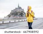 young female traveler in yellow ...   Shutterstock . vector #667908592