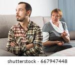 elderly mother and son quarrel... | Shutterstock . vector #667947448