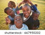 elementary school kids having... | Shutterstock . vector #667950202