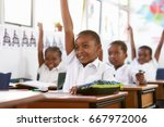 kids raising hands during a... | Shutterstock . vector #667972006