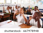kids showing hands during a... | Shutterstock . vector #667978948