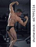 handsome bodybuilder posing in...   Shutterstock . vector #667991116