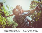 single father on meadow with... | Shutterstock . vector #667991596
