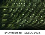 Small photo of Motion blur abstraction of glowing computer keyboard alphanumeric latin and cyrillic keys with green backlit isolated on black background.
