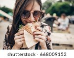 stylish hipster woman holding... | Shutterstock . vector #668009152