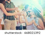 group of friends drinking ... | Shutterstock . vector #668021392