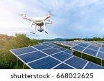 drones flying over solar cells   Shutterstock . vector #668022625