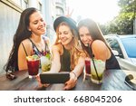 three young woman at cafe... | Shutterstock . vector #668045206