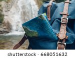 hipster blue backpack  and map... | Shutterstock . vector #668051632