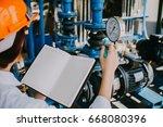 industrial engineers working... | Shutterstock . vector #668080396