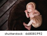 the newborn baby in a cap sleeps | Shutterstock . vector #668081992