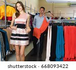 young woman is trying on new... | Shutterstock . vector #668093422