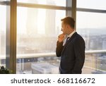 young businessman looking... | Shutterstock . vector #668116672