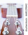 Small photo of close up ukulele on white background