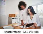 two young women running a small ... | Shutterstock . vector #668141788