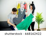 woman has nothing to wear | Shutterstock . vector #668162422