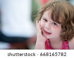 young little girl sitting down... | Shutterstock . vector #668165782