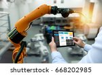 engineer hand using tablet ... | Shutterstock . vector #668202985