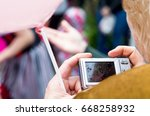 a woman takes pictures on a... | Shutterstock . vector #668258932