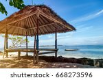wooden bungalows with thatched... | Shutterstock . vector #668273596