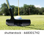 a putter is lined up behind a...   Shutterstock . vector #668301742