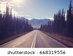 straight narrow forest road... | Shutterstock . vector #668319556