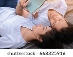 couple reading a book together... | Shutterstock . vector #668325916