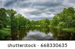 green trees and river on a... | Shutterstock . vector #668330635