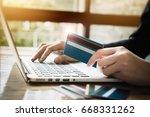 online payment woman's hands... | Shutterstock . vector #668331262