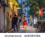 Small photo of TOKYO, JAPAN - JUNE 28TH 2017. View of a street sidewalk in Ikejiri Ohashi neighbourhood. The neighbourhood is within a short walking distance from the more popular Shibuya District.