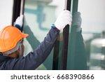the technician's hands will... | Shutterstock . vector #668390866