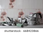 a huge pile of unwashed dishes... | Shutterstock . vector #668423866