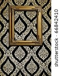 Gold picture frame on Thai traditional pattern wall for decoration - stock photo
